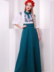 Оригинальное изумрудное платье декорированное принтом с цветочной композицией