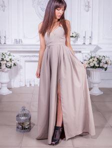 Длинное нарядное платье на тонких бретелях с разрезом