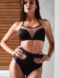 Черный стильный раздельный купальник с вставками прозрачной сетки