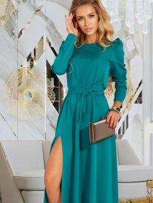 Длинное зеленое шелковое нарядное платье с разрезом на длинный рукав
