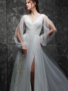 Вечернее платье в пол с разрезами на рукавах