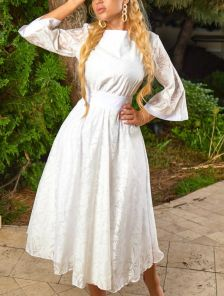 Белое нарядное платье миди с красивіми узорами