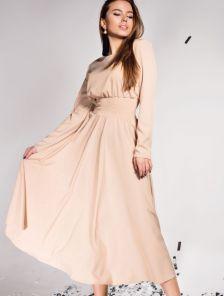 Бежевое красивое платье а силуэта