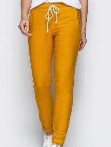 Стрейчевые брюки в желтом цвете