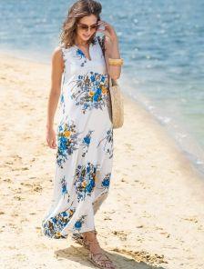 Длинное платье с ярким цветочным принтом под пояс